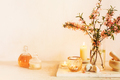 Scented candles, essential oils, marble mortar and wild almonds flowers on a table - PhotoDune Item for Sale