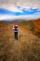 Middle aged active caucasian female model with backpack walk in mountains autumn time - PhotoDune Item for Sale