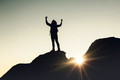 Man with arms raised at sunset - PhotoDune Item for Sale