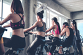People working out at spinning class in the gym. - PhotoDune Item for Sale