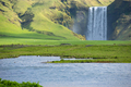 Skogafoss waterfall, Southern Iceland, is one of country's most epic tourist destinations - PhotoDune Item for Sale