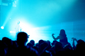Silhouette of concert crowd in front of bright stage lights - PhotoDune Item for Sale