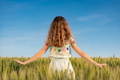 Portrait of beautiful girl against summer field and sky background - PhotoDune Item for Sale
