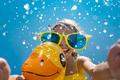 Spring break! Happy child having fun on summer vacation - PhotoDune Item for Sale