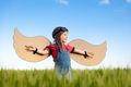 Happy child with cardboard wings playing outdoor in summer - PhotoDune Item for Sale