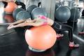 Asian sexy women  exercise on orange ball. - PhotoDune Item for Sale
