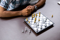 Man developing chess strategy, playing board game. - PhotoDune Item for Sale