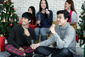 Happy party of young Asian with drink wine and sing a song at home in celebrate Christmas festival. - PhotoDune Item for Sale