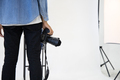 Young photographer man holding professional digital camera in the studio. - PhotoDune Item for Sale