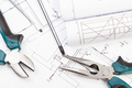 Pliers, screwdriver and diagrams of plan with electrical installation. Building home - PhotoDune Item for Sale
