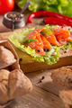 Slices of smoked salmon with dill, chile pepper, tomatoes and bread - PhotoDune Item for Sale