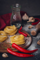 Raw homemade pasta with flour and spices on the rustic background. - PhotoDune Item for Sale