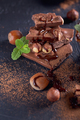 Homemade hazelnut spread or hot chocolate in glass bowl with nuts and chocolate bar. - PhotoDune Item for Sale