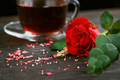 Tea in a transparent cup, color candies and a red rose - PhotoDune Item for Sale
