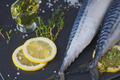 Fresh raw fish mackerel and ingredients for cooking on a dark background in a rustic style. - PhotoDune Item for Sale
