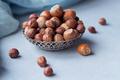 Hazelnut in light blue background. - PhotoDune Item for Sale