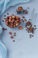 Hazelnut, coffee beans and cocoa powder in light blue background. - PhotoDune Item for Sale