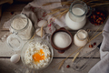 Fresh dairy products: milk, cottage cheese, sour cream and wheat on rustic wooden background. - PhotoDune Item for Sale