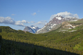 Morning view of Lone Walker and Rising Wolf mountains in Glacier National Park - PhotoDune Item for Sale