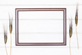Empty wooden picture frame on white painted wood boards with wheat ears - PhotoDune Item for Sale