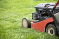 Lawn mover on green grass. Machine for cutting lawns. - PhotoDune Item for Sale