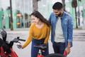 Young people renting electric bicycle with smartphone app - Focus on man face - PhotoDune Item for Sale