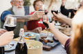 Multi generational people cheering with wine and eating outdoors at home - PhotoDune Item for Sale