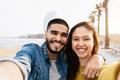 Happy couple having fun doing selfie in barcelona city - Focus on faces - PhotoDune Item for Sale