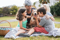 Young parents having fun with children and their pet outdoor at park in summer time - PhotoDune Item for Sale
