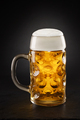 Stein with fresh beer with cap of foam on a black. - PhotoDune Item for Sale