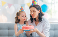 Mother and daughter are celebrating birthday. - PhotoDune Item for Sale