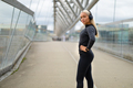 Woman in Black Workout Outfit Standing At Modern Bridge In City - PhotoDune Item for Sale