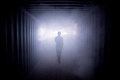 Silhouette of a man walking in a dark tunnel to the light, concept of death - PhotoDune Item for Sale