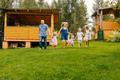 Happy family running in garden on grass. - PhotoDune Item for Sale