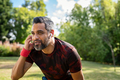 Mixed race mature man taking a break while jogging outdoor - PhotoDune Item for Sale