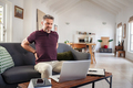 Mature man stretching back while working at home - PhotoDune Item for Sale