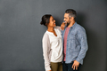 Multiethnic couple looking at each other with a smile - PhotoDune Item for Sale
