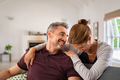 Laughing mature woman embracing man and having fun together - PhotoDune Item for Sale