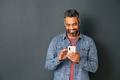 Mature indian man messaging on smartphone - PhotoDune Item for Sale