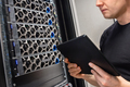 Male IT Support Professional With Digital Tablet Examining Hyper Converged Server Hardware - PhotoDune Item for Sale