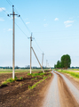 Rural road passing along the electric poles - PhotoDune Item for Sale