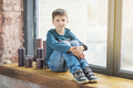 teen boy sitting behind the window and smile - PhotoDune Item for Sale