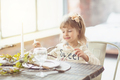 girl sitting at the table and holding fork and knife in her hands. Ready to eat - PhotoDune Item for Sale
