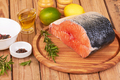 Salmon steak on a board on wooden table - PhotoDune Item for Sale