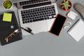 Office desk with modern gadgets on a grey desk - PhotoDune Item for Sale