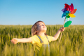 Happy child enjoying the sun outdoor in green field - PhotoDune Item for Sale