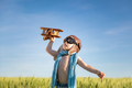 Happy child with airplane playing outdoor in summer - PhotoDune Item for Sale