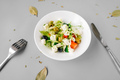 Greek salad on gray background. Front view. - PhotoDune Item for Sale