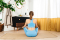 Young woman practicing yoga indoor. Morning ritual. - PhotoDune Item for Sale