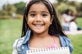 Portrait of indian female kid at city park - PhotoDune Item for Sale